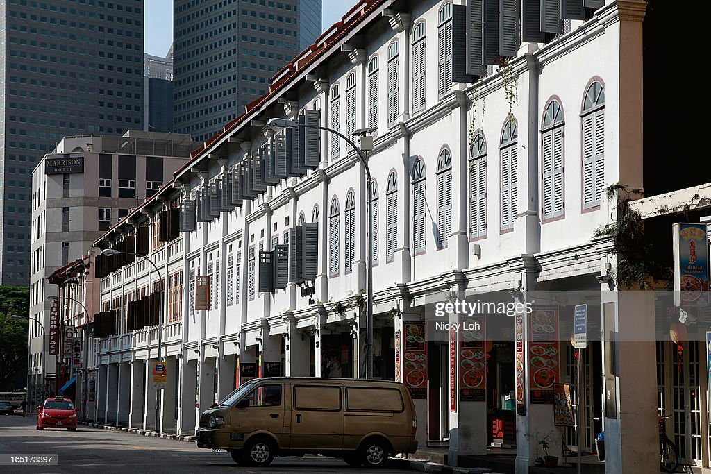 A row of shophouses on near Bugis Junction on April 1, 2013 in Singapore. A shophouse is a vernacular architectural building type that is commonly seen in areas such as urban Southeast Asia. Shophouses are mostly two or three stories high, with a shop on the ground floor for mercantile activity and a residence above the shop. This pre-industrial form of urban units, prevalent in 19th and early 20th century Southeast Asian towns, cities and commercial centres, literally housed everything from work to home. Today, these buildings are recognised for their significance not only as an architectural heritage but more importantly as a reflection of the island's societal history and development.