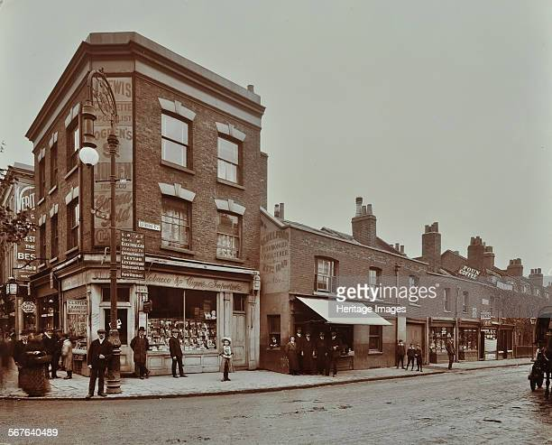 Row of shops at 17 Lea Bridge Road Hackney London September 1909 People standing outside shops including a tobacconist's and a fishmonger's One man...