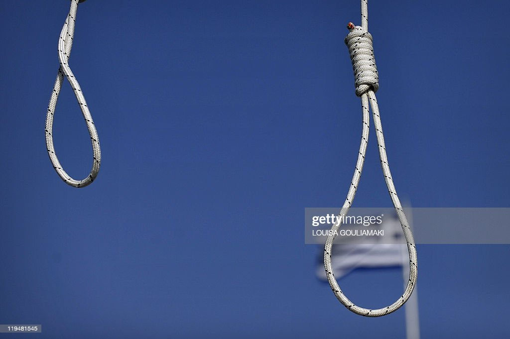 Row of six nooses are displayed opposite of the parliament building on July 20 2011 as a gesture to threaten deputies who last month approved a new...