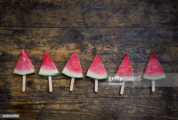 Row of six watermelon popsicles