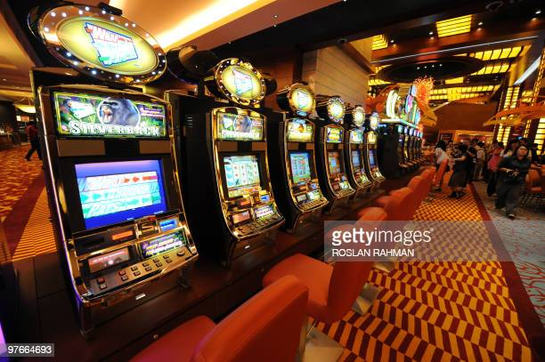 A row of slot machines await gamblers at the opening of Singapore's first casino the Resorts World Sentosa complex in Singapore on February 14 2010...