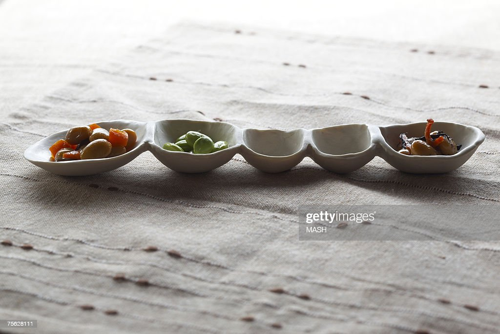 Row of small bowls with Japanese food : Stock Photo
