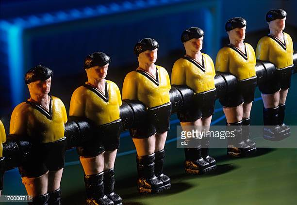Row of soccer toy players