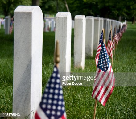 Row of soldiers headstones with American flags