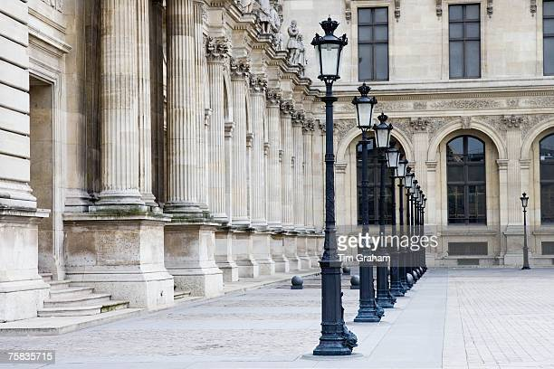 Row of street lights by Louvre Museum Paris France