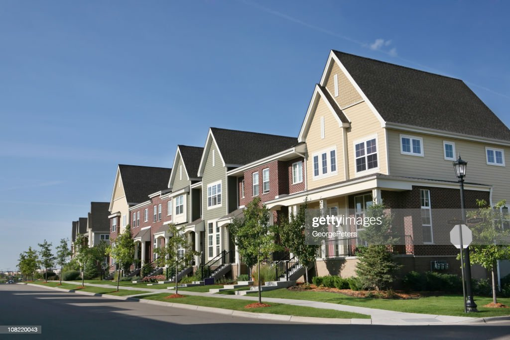 Row of Suburban Townhouses on Summer Day : Stock Photo