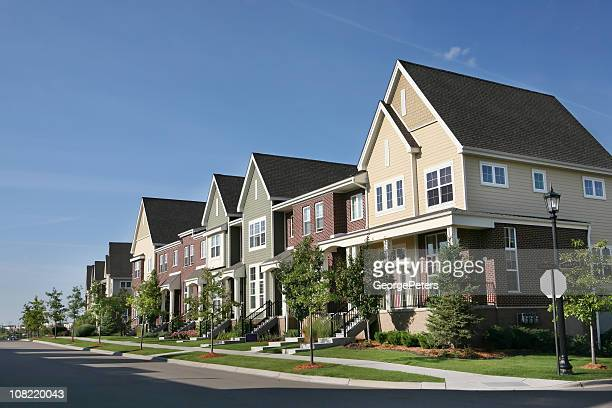 Row of Suburban Townhouses on Summer Day