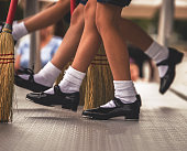 A line of tap dancers in the middle of a routine