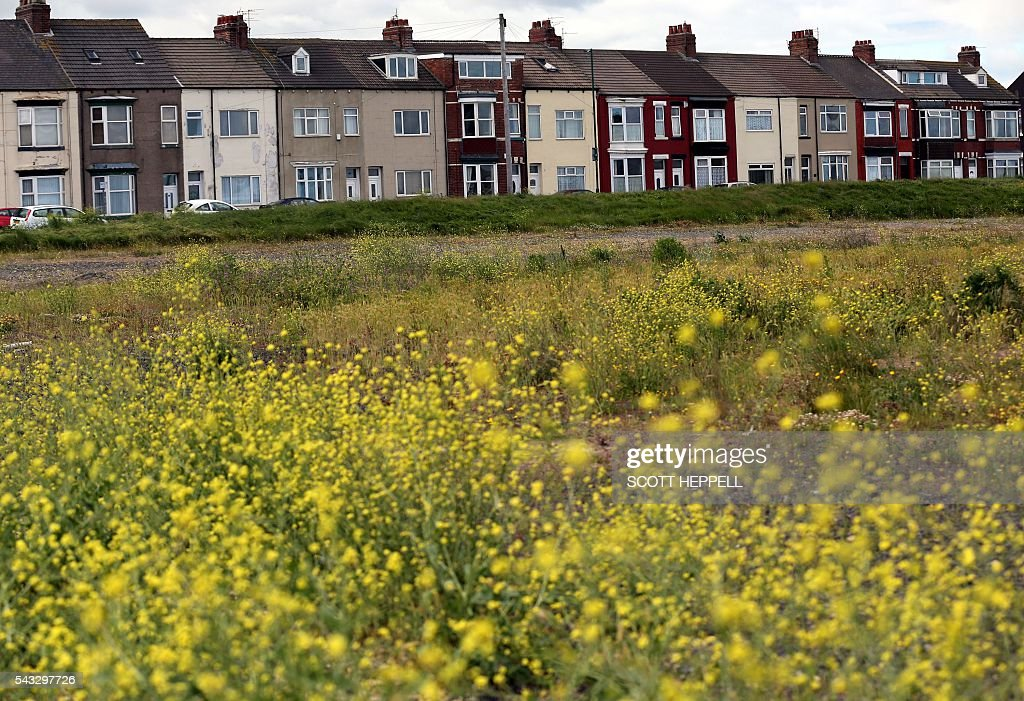 A row of terraced houses is pictured in Redcar, north east England on June 27, 2016 Britain's historic decision to leave the 28-nation bloc has sent shockwaves through the political and economic fabric of the nation. It has also fuelled fears of a break-up of the United Kingdom with Scotland eyeing a new independence poll, and created turmoil in the opposition Labour party where leader Jeremy Corbyn is battling an all-out revolt. / AFP / Scott Heppell