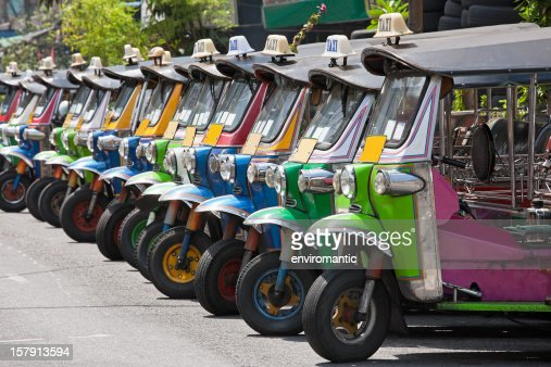 Row of Thai Tuk-tuks.