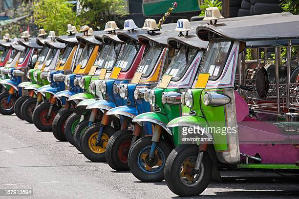 Row of Thai Tuk-tuks.
