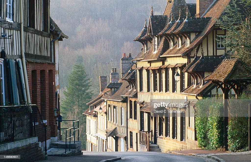 Row of timbered houses lining steep hill, Lyons-la-Foret, Eure. : Stock Photo