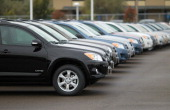 A row of Toyota RAV4s are displayed on the sales lot at a Toyota dealership on February 24 2011 in Oakland California Toyota announced today that it...