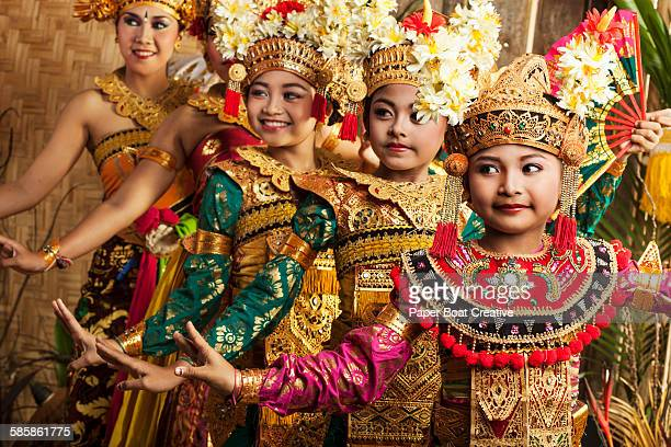 Row of traditional Balinese dancers in costume