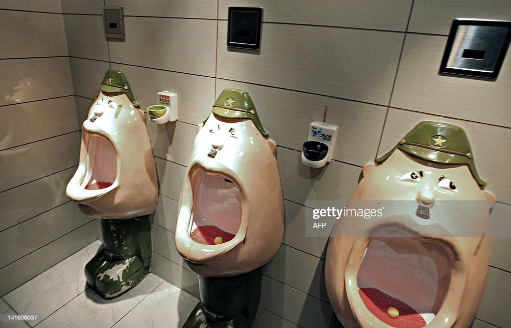 A row of urinals depicting kneeling Japanese soldiers with their mouths wide open are seen in the toilets of an hotel in Harbin, northeast China's Heilongjiang province on March 19, 2012, as recently posted on China's popular micoblogging site Weibo, a Twitter-like service. Relations between Tokyo and Beijing are often tested by history and by spats over disputed islands in the East China Sea that are believed to be rich in resources. CHINA