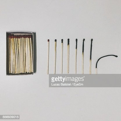 Row Of Used Matches On White Table