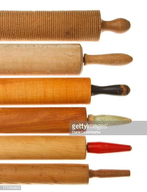 Row Of Vintage Rolling Pins On White