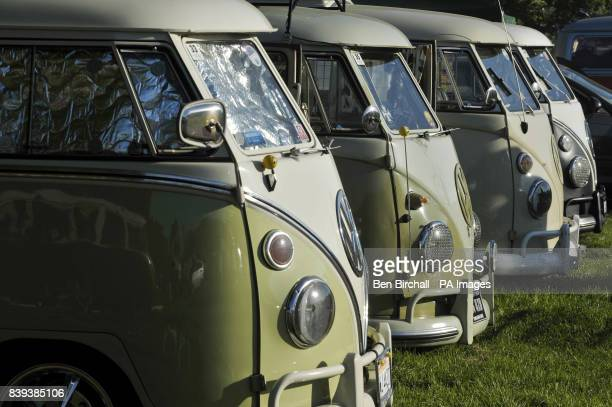 A row of VW Splitscreen Type 2 Transporter line up at Vanfest festival in the Three Counties Showground Malvern where thousands of VW transporters...