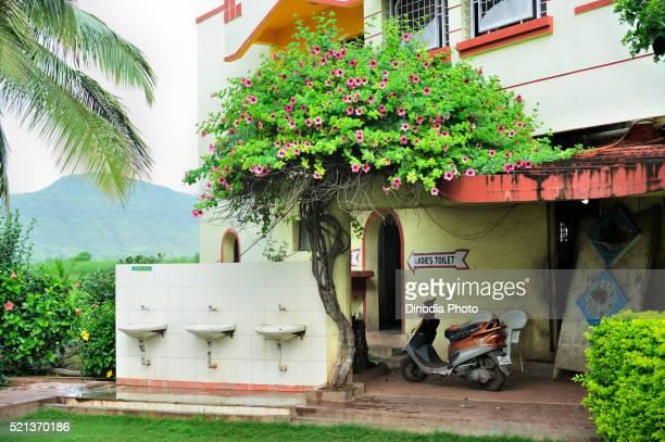 Row of wash basin in hotel garden at satara, Maharashtra, India, Asia