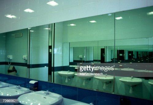 Public Bathroom Mirror row of wash basins and mirrors in public bathroom stock photo