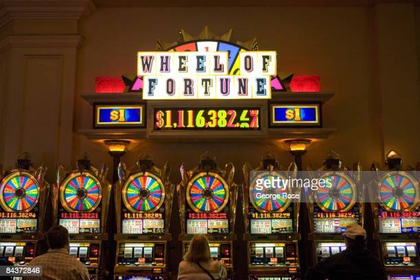A row of Wheel of Fortune slot machines at the Venetian Hotel Casino located on the famed Las Vegas Strip are seen in this 2009 Las Vegas Nevada photo
