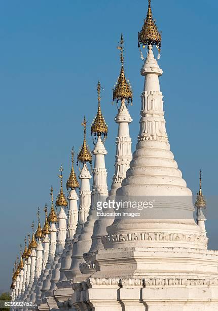 Row of white stupas at Sandamuni Sanda Muni Pagoda Paya Mandalay Burma Myanmar