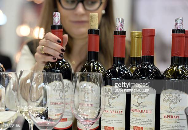 A row of wine bottles produced by a Georgian winery is exposed at a stand of the Vinexpo wine fest in Bordeaux on June 15 2015 Released in France's...