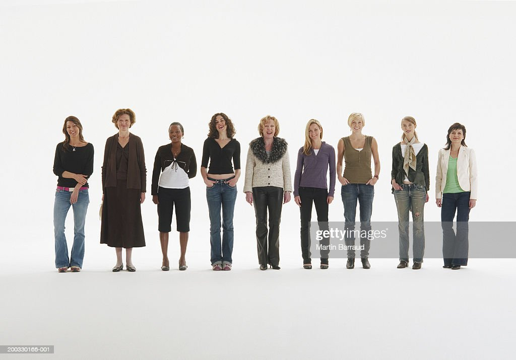 Row of women standing in line, smiling, portrait : Stock Photo