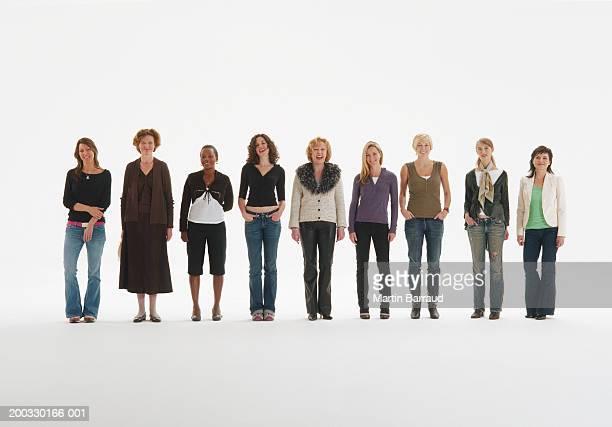 Row of women standing in line, smiling, portrait