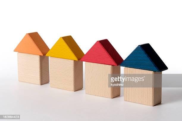 Row of wood block house on white background