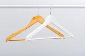 Row of wooden empty hangers