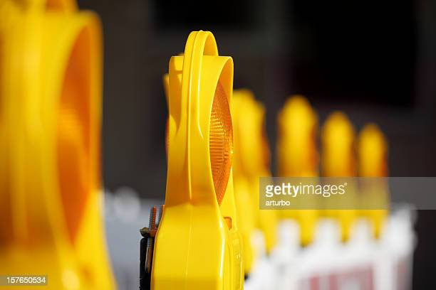 row of yellow and orange traffic  warning lamps