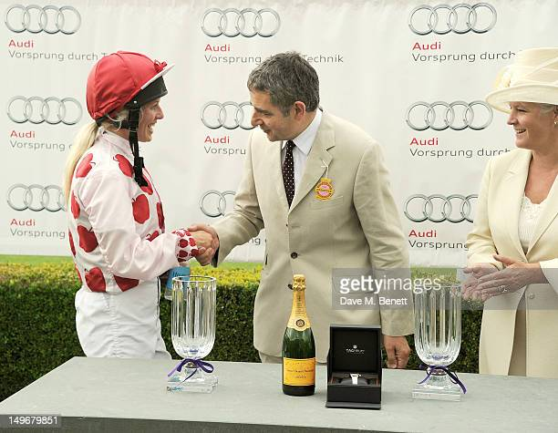 Rowan Atkinson and Lady March present the Magnolia Cup to winner Philippa Holland during Ladies Day at Glorious Goodwood held at Goodwood Racecourse...