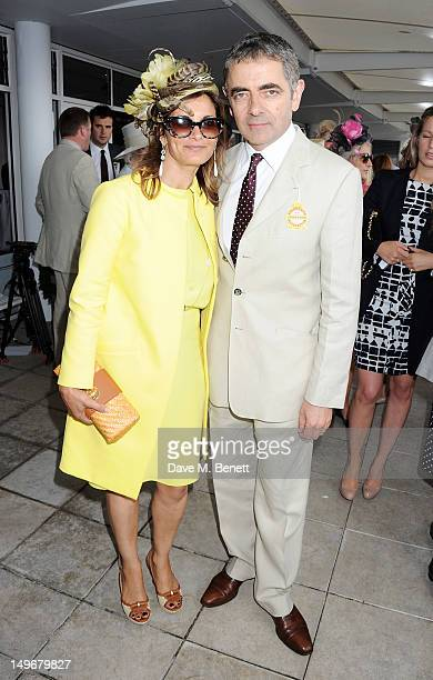 Rowan Atkinson and wife Sunetra Sastry attend Ladies Day at Glorious Goodwood held at Goodwood Racecourse on August 2 2012 in Chichester England