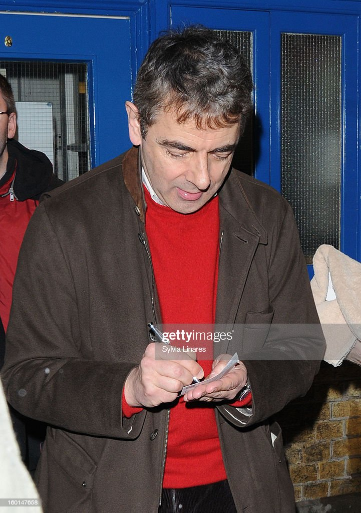 <a gi-track='captionPersonalityLinkClicked' href=/galleries/search?phrase=Rowan+Atkinson&family=editorial&specificpeople=206215 ng-click='$event.stopPropagation()'>Rowan Atkinson</a> leaving Wyndham Theatre on January 26, 2013 in London, England.