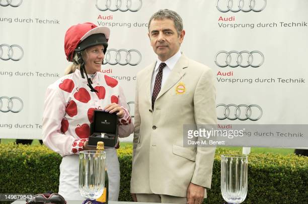 Rowan Atkinson presents the Magnolia Cup to winner Philippa Holland during Ladies Day at Glorious Goodwood held at Goodwood Racecourse on August 2...