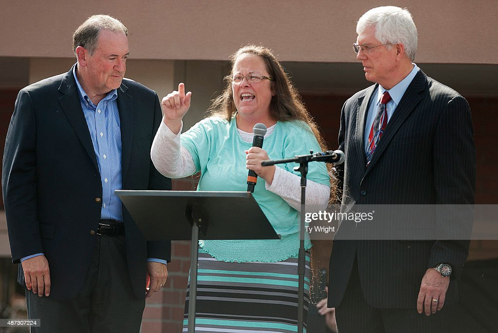 Rowan County Clerk of Courts Kim Davis speaks next to her attorney Mat Staver (R) and Republican presidential candidate Mike Huckabee (L) in front of the Carter County Detention Center on September 8, 2015 in Grayson, Kentucky. Davis was ordered to jail last week for contempt of court after refusing a court order to issue marriage licenses to same-sex couples.