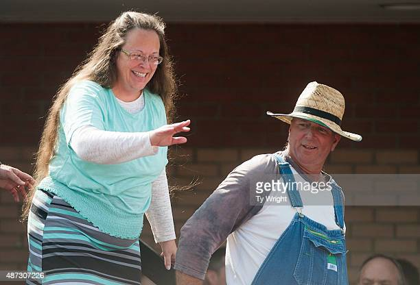 Rowan County Clerk of Courts Kim Davis walks off stage with her husband Joe Davis in front of the Carter County Detention Center on September 8 2015...