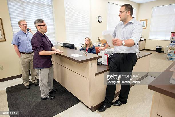 Rowan County Deputy Clerk Nathan Davis right informs David Moore center and David Ermold left that he won't issue them a marriage license Thursday...