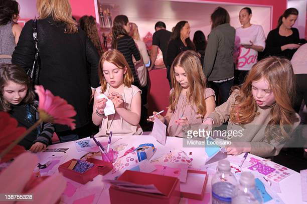 Rowan Francis Henchy and Grier Hammond Henchy attends Barbie The Dream Closet Playdate Saturday February 11th at David Rubenstein Atrium on February...