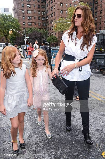Rowan Francis Henchy Grier Hammond Henchy and Brooke Shields enter the MercedesBenz Fashion Week at The Theatre at Lincoln Center on September 8 2012...
