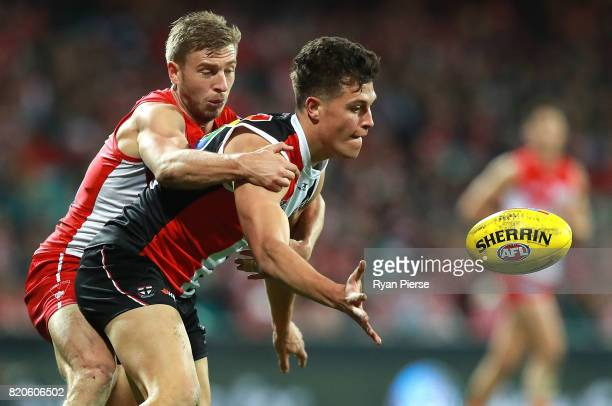 Rowan Marshall of the Saints is tackled by Kieren Jack of the Swans during the round 18 AFL match between the Sydney Swans and the St Kilda Saints at...
