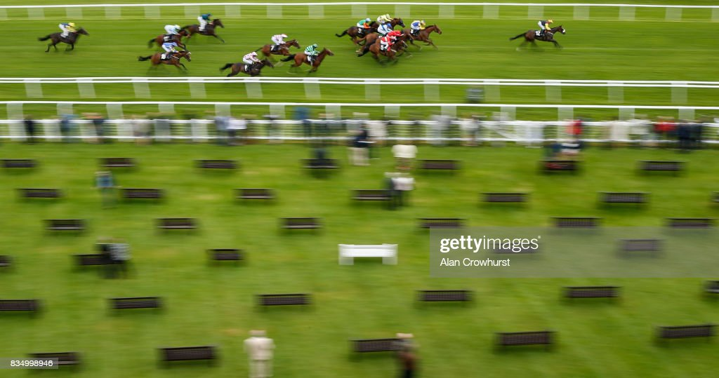 Rowan Scott riding Set In Stone (R) win The Christopher Smith Associates handicap Stakes at Newbury racecourse on August 18, 2017 in Newbury, England.