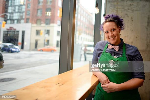 Rowan Williams shows off part of the new dress code at Starbucks on Adelaide St near Peter St on July 25 2016 Starbucks Canada has introduced changes...