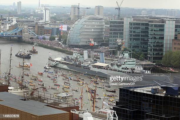 Rowbarge Gloriana and the manpowered section of the flotilla approaching Tower Bridge pass HMS Belfast as seen from The Monument as they participate...