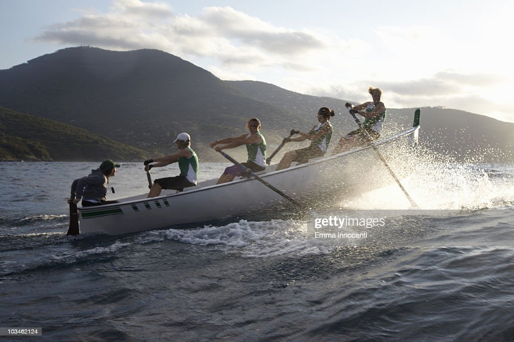 rowboat against high wave : Stock Photo