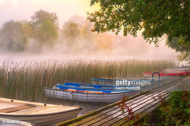 Rowboats moored at a wooden jetty
