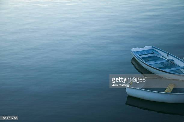Rowboats on serene water