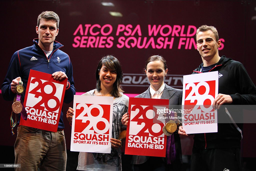 rower Gregory Searle, Malaysian squash-player Nicol David, cyclist Victoria Pendleton and squash player Nick Matthew pose with 2020 Back the Bid signs aimed at getting Squash into the 2020 Olympics during Day 3 of the World Series Finals held at Queens Club on January 4, 2013 in London, England.