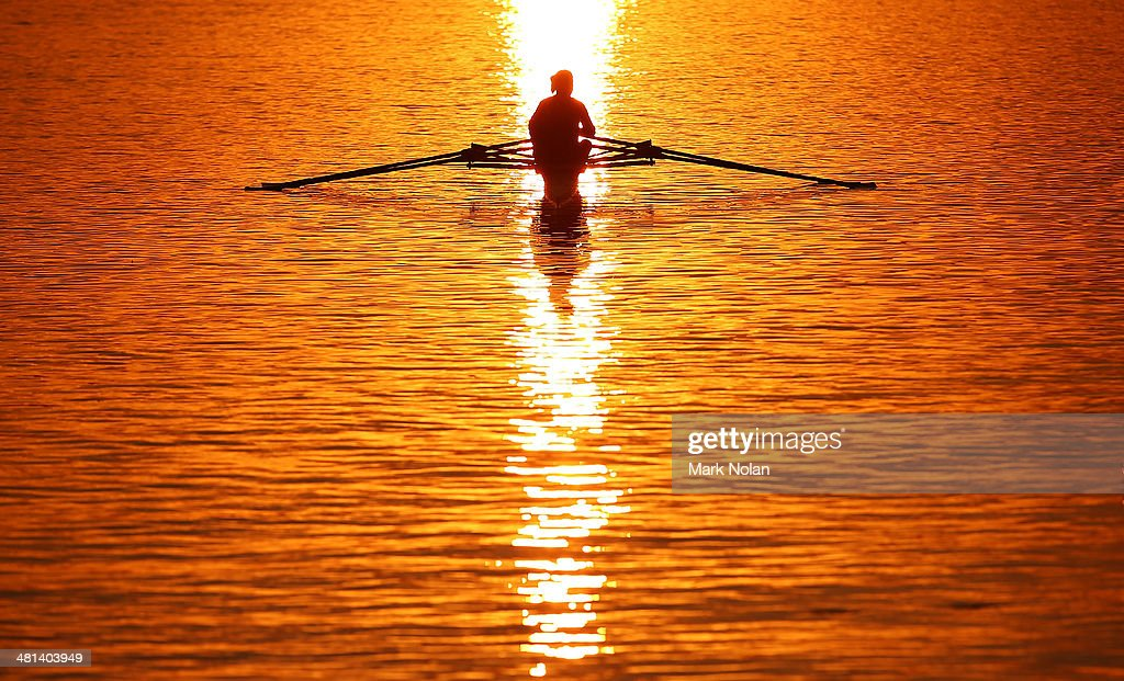 A rower heads out for training early morning before the Rowing World Cup at the Sydney International Rowing Centre on March 30, 2014 in Sydney, Australia.